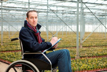 Man in wheelchair in greenhouse_small