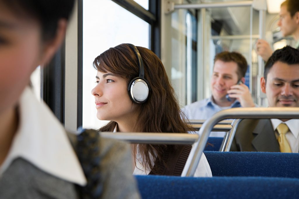 women-with-headphones-on-bus_2850x1900